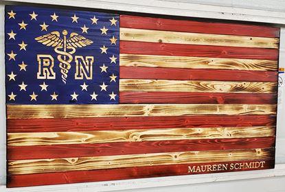 Carved wooden  nurse flag